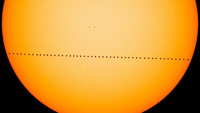 thumbnail timelapse photo of Mercury crossing face of Sun