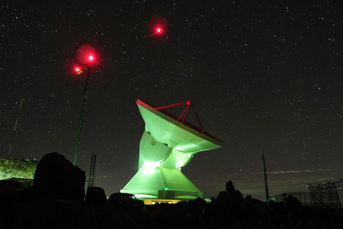 several stories tall radio telescope at night
