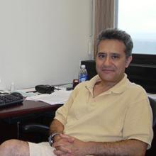 photo of Mauro Giavalisco sitting in front of desk